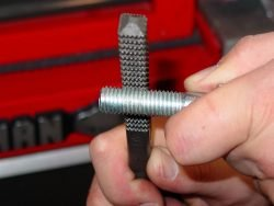 A thread file is a tool that can be used for restoring damaged male threads on bolts and threaded studs